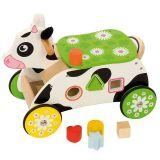 Bigjigs Baby Dřevěný motorický vozík kravička