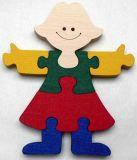Dřevěné vkládací puzzle Holka bez rámečku