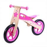 Dřevěné hračky Bigjigs Toys dřevěné odrážedlo Růžové kolo