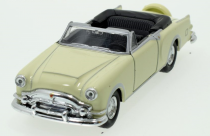 Welly - Packard Caribbean (1953) model 1:34 krémová